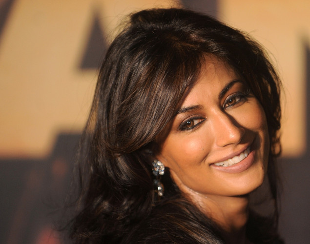 Bollywood actress Chitrangada Singh poses for the media after arriving at the green carpet to attend the premier of the new movie 'Shanghai' during the International Indian Film Academy (IIFA) awards event, in Singapore.