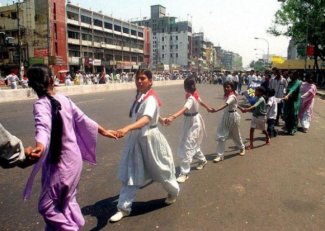 In a file photo Bangladeshi school children form a human chain in Dhaka in 2000 in support of a planned hunger strike by Humayun Ahmed in an attempt to get his university reopened.