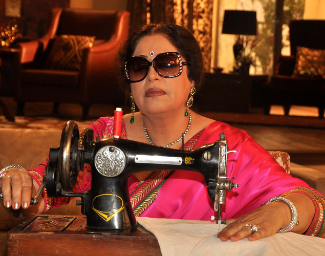 Kirron Kher poses during a promotional event for the Hindi film 'Ajab Gazabb Love' in Mumbai.