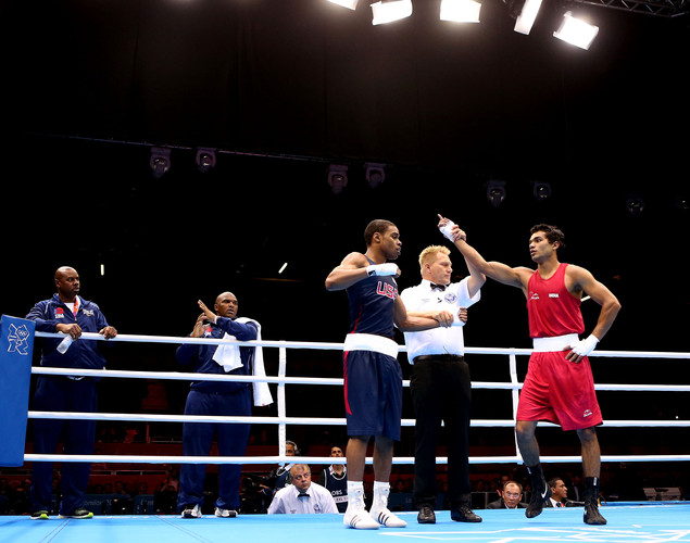 Krishan Vikas of India (R) is awarded the victory over Errol Spence of United States during the Men's Welter (69kg) Boxing on Day 7 of the London 2012 Olympic Games at ExCeL on August 3, 2012 in London, England.