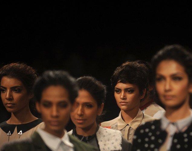 Models showcase creations by designer Ruchika Sachdeva on the final day of Lakme Fashion Week (LFW) winter/festive 2012 in Mumbai on August 7, 2012.