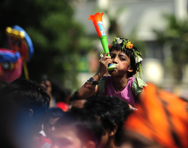 "A Bangladeshi child attends a rally in celebration of the Bengali New Year or ""Pohela Boishakh"" in Dhaka."