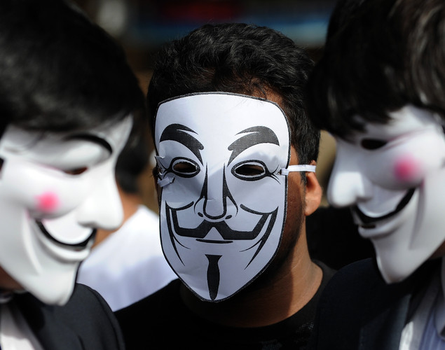 Activists supporting the group Anonymous wear masks as they protest against the Indian Government's increasingly restrictive regulation of the internet in Mumbai.