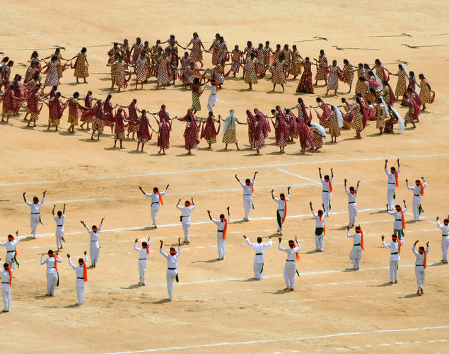 Indian school children give a cultural performance as part of Independence Day celebrations at the Manek Shaw Parade Grounds in Bangalore on August 15, 2012.