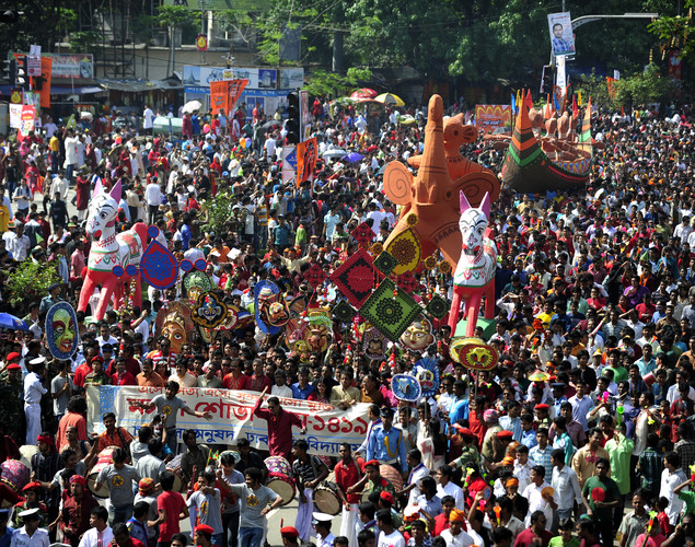 "Revellers attend a rally in celebration of the Bengali New Year or ""Pohela Boishakh"" in Dhaka."