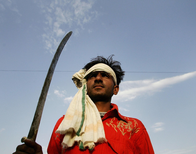A Rajasthani man carrying a sword.