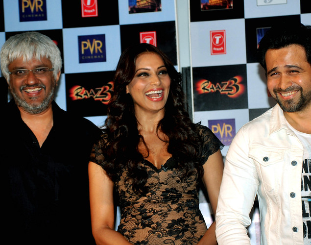 Bollywood film actors Bipasha Basu (R) and Emraan Hashmi pose during the launch of the first trailer of upcoming Hindi horror thriller film 'Raaz 3' directed by Vikram Bhatt (L) in Mumbai.