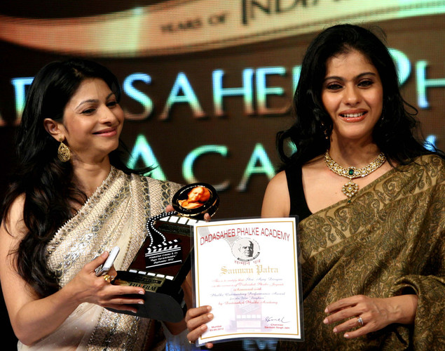 "Kajol (R) and her sister Tanisha (L) attend the ""143rd Dadasaheb Phalke Academy Awards 2012"" ceremony, celebrating Indian Cinema in Mumbai."