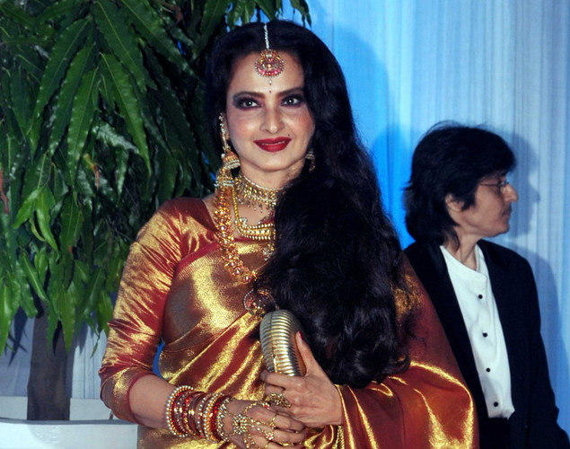 Bollywood film actress Rekha poses during the wedding reception ceremony of film actress Esha Deol and husband Bharat Takhtani in Mumbai.