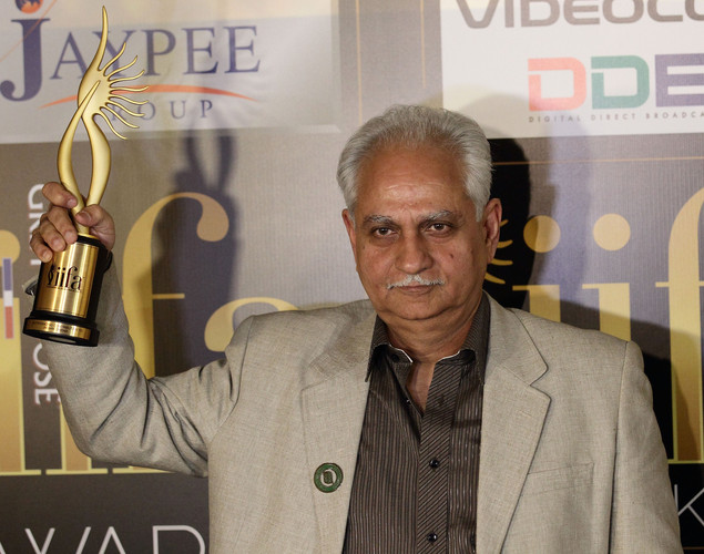 Ramesh Sippy wins the award for Oustanding Contribution to Indian Cinema at the 2012 International India Film Academy Awards at the Singapore Indoor Stadium.