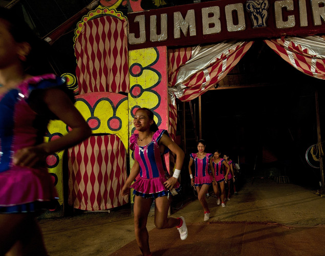 Performers enter the ring during to start off the evening's show at the Jumbo Circus in Gurgaon.