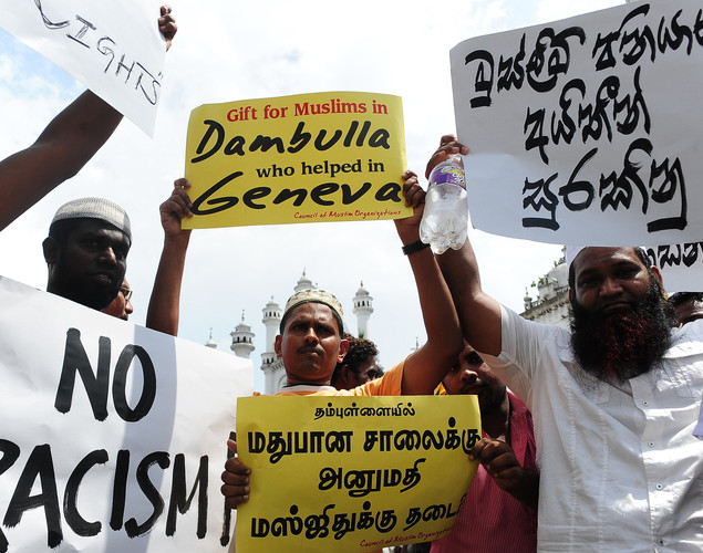Sri Lankan Muslims take part in a protest against the planned relocation of a mosque after congregational Friday prayers in Colombo on April 27, 2012.