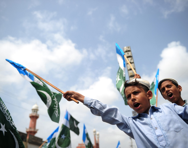 Activists of Jamaat e Islami Pakistan shout slogans during a rally in Karachi to denounce the resumption of NATO supplies into Afghanistan. Islamabad reopened overland routes to NATO convoys earlier this week after closing them in protest at a US air raid that killed 24 Pakistani soldiers at a border post in November.