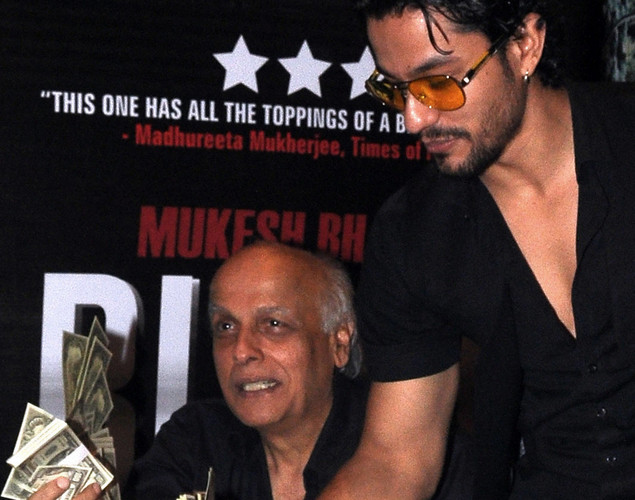 Kunal Khemu (R) and director Mahesh Bhatt attend the success party for the cast of Hindi film 'Blood Money' in Mumbai.