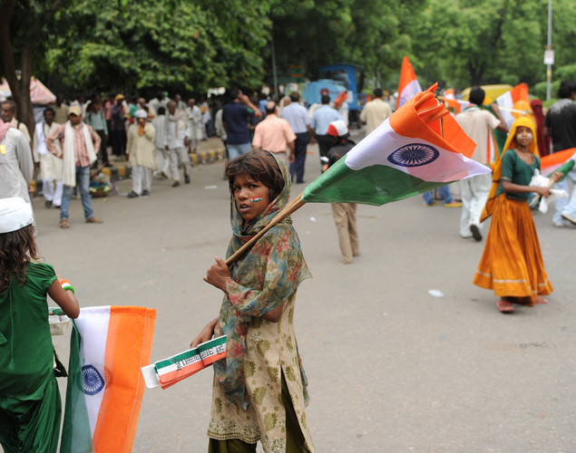 Indian vendors sell flags to supporters of anti-corruption activist Anna Hazare during a protest in New Delhi.
