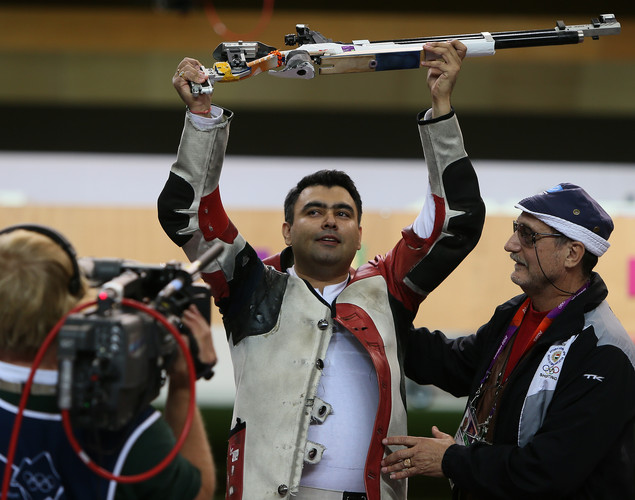 India's Gagan Narang (L) jubilates with his coach after winning the bronze medal in the men's 10m air rifle final during the London 2012 Olympic Games at the Royal Artillery Barracks in London on July 30, 2012.