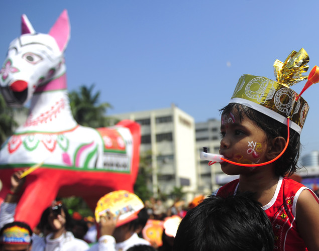 "A Bangladeshi child attends a rally to mark the Bengali New Year or ""Pohela Boishakh"" in Dhaka."