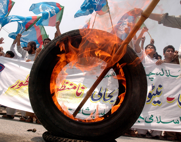 Activists of Pakistani political and Islamic party Jammat-e-Islami (JI) shout slogans during a protest against the Pakistani government's open NATO supplies route to Afghanistan.