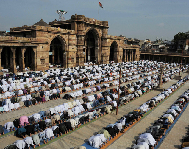 Indian Muslims offer Eid al-Fitr prayers at the Shahi Jama Masjid Mosque in the Walled City of Ahmedabad.