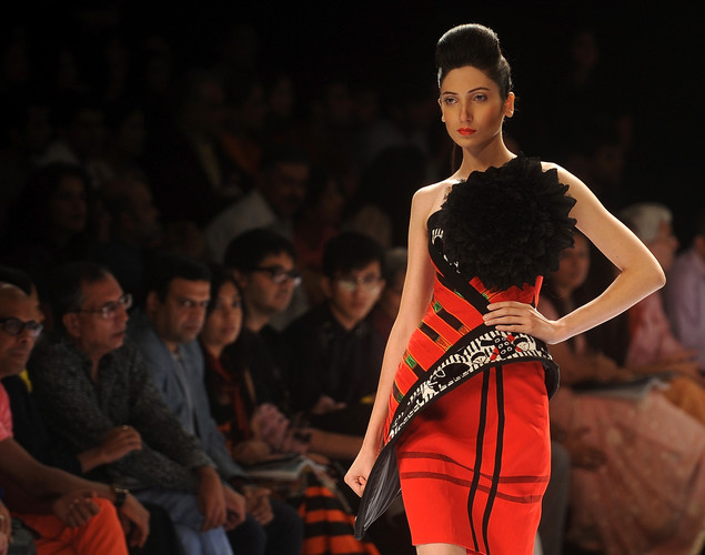 A model showcases a creation during the Next Generation fashion show on the first day of Lakme Fashion Week (LFW) winter/festive 2012 in Mumbai on August 3, 2012.