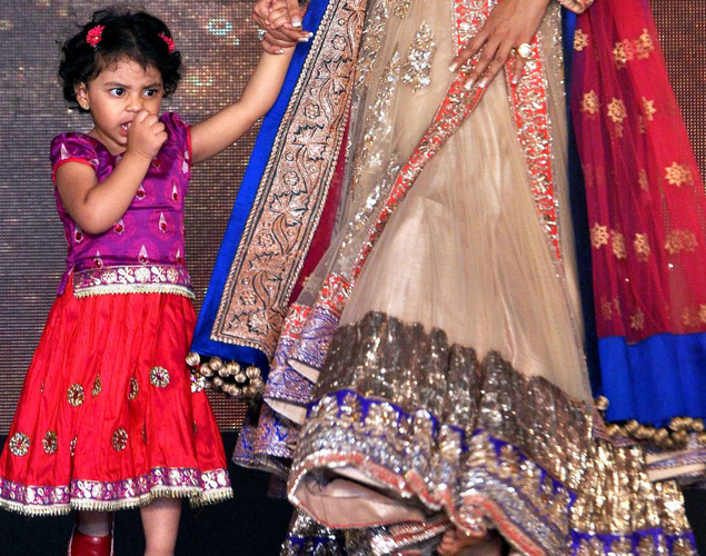 Sushmita Sen's daughter Alisah walks the ramp  displaying creations by designer Manish Malhotra for a public awareness campaign Save and Empower the Girl Child in Mumbai.