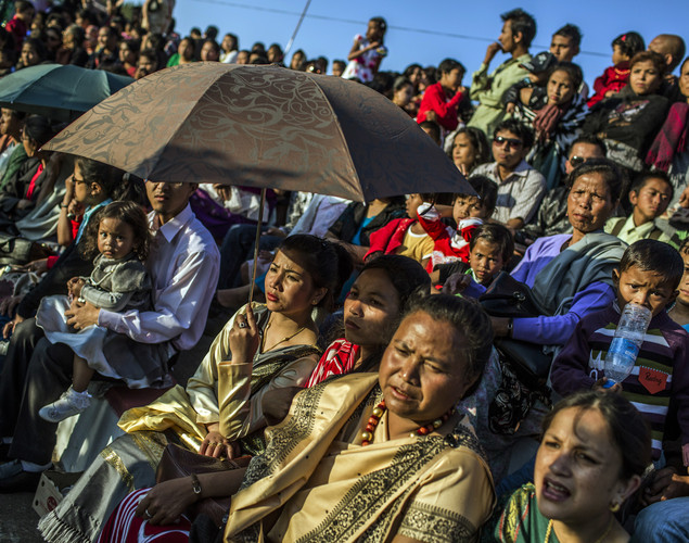 Familiy and friends of Tribal Khasi maidens, watch from the stand during the Shad Suk Mynsiem Festival.