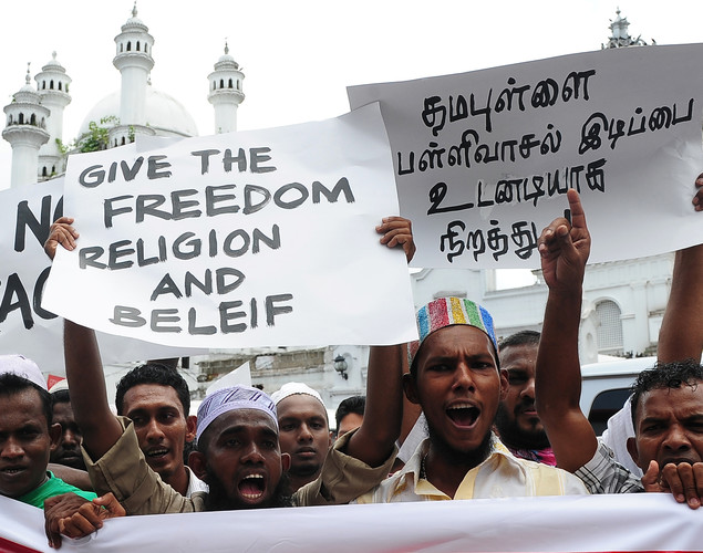 Sri Lankan Muslims take part in a protest after Friday noon prayers in Colombo on April 27, 2012.