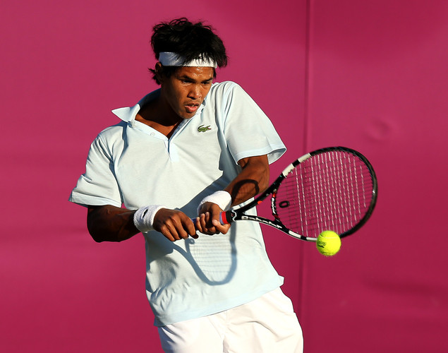 Somdev Devvarman of India plays a backhand during the Men's Singles Tennis match against Jarkko Nieminen of Finland on Day 2 of the London 2012 Olympic Games at the All England Lawn Tennis and Croquet Club in Wimbledon on July 29, 2012 in London, England.