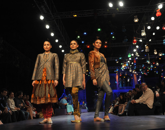 Indian models showcase creations by Indian designer JJ Valaya during the Grand Finale of Aamby Valley India Bridal Fashion Week 2012 in Mumbai.
