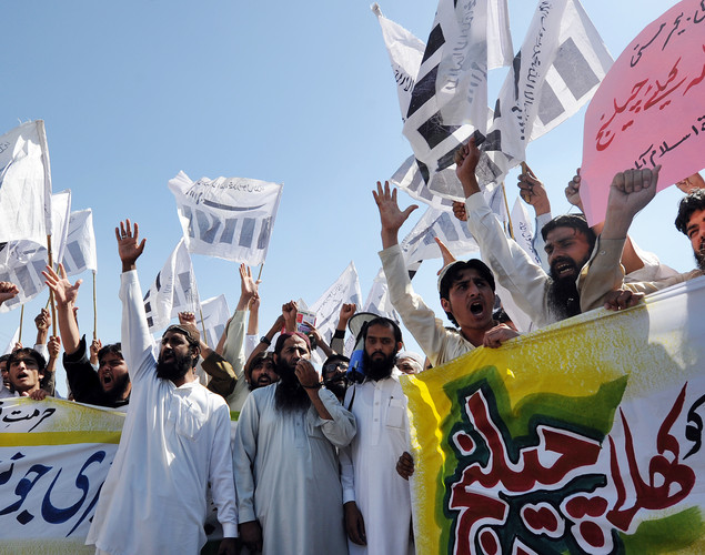 Supporters of Pakistan's outlawed Islamic hardline Jamaat ud Dawa (JD) group shout slogans against United States pastor Terry Jones, over the recent burning of the Koran by Jones at his Florida church, in Islamabad.