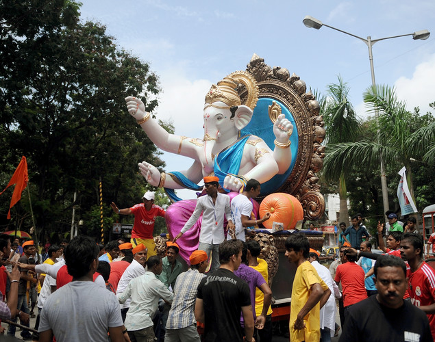Indian Hindus pull a huge idol of the elephant-headed Hindu god Lord Ganesha through the streets of Mumbai.