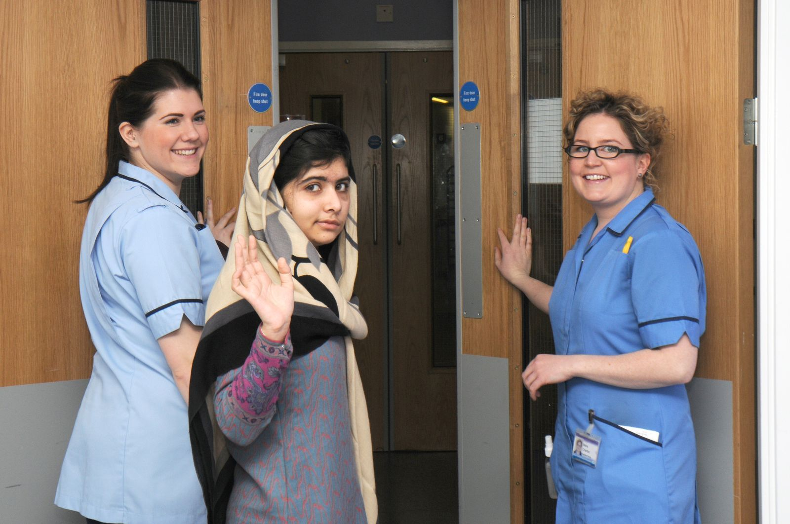 This photo made available by Queen Elizabeth Hospital, Birmingham, England shows Malala Yousufzai saying goodbye as she is discharged from the hospital to continue her rehabilitation at her family's temporary home in the area, Friday, Jan. 4, 2013