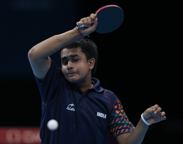 Soumyajit Ghosh of India plays a forehand in his Men's Singles second round match against Hyok Bong Kim of Korea on Day 2 of the London 2012 Olympic Games at ExCeL on July 29, 2012 in London, England.