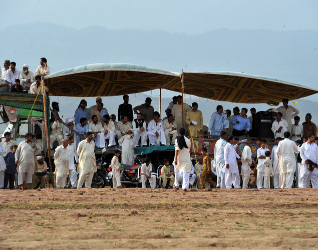 Pakistani farmers and villagers watch a bull race competition on the outskirts of Islamabad.