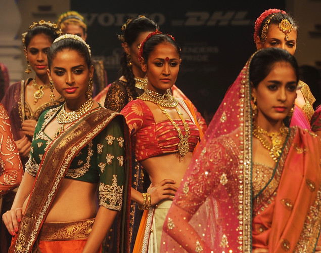 Models showcase creations by Indian designer Neeta Lulla on the final day of Lakme Fashion Week (LFW) winter/festive 2012 in Mumbai on August 7, 2012.