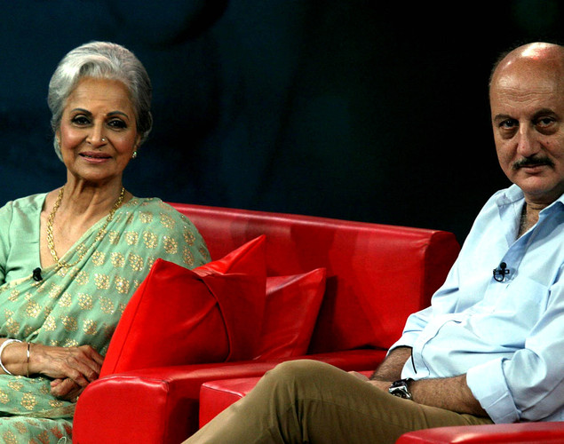 Waheeda Rehman (R) and Anupam Kher sit onstage during the NDTV talk show 'Issi Ka Naam Zindagi' in Mumbai on April 19, 2012.