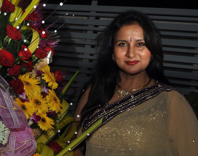 Poonam Dhillon smiles during her birthday celebration in Mumbai on April 18, 2012.