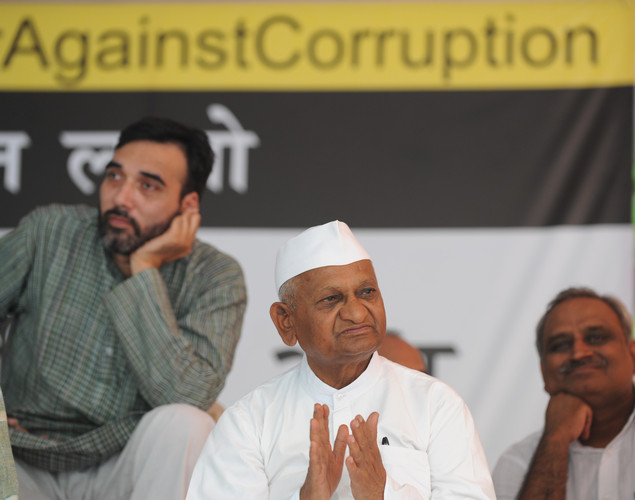 Anti-corruption activist Anna Hazare (C) sits during a protest  in New Delhi .