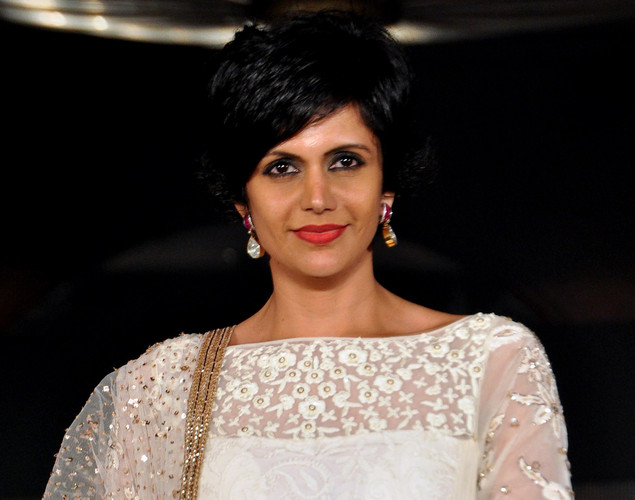 Mandira Bedi displays a creation by designer Manish Malhotra for a public awareness campaign Save and Empower the Girl Child in Mumbai.
