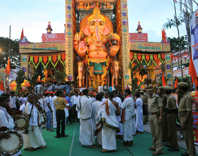 Indian police look on as devotees gather to offer prayers at a 58-foot (17.57 meter) tall idol of the Hindu god Lord Ganesh, popularly known as 'Khairatabad Ganesh', during the festival of 'Ganesh Chaturthi' in Hyderabad.