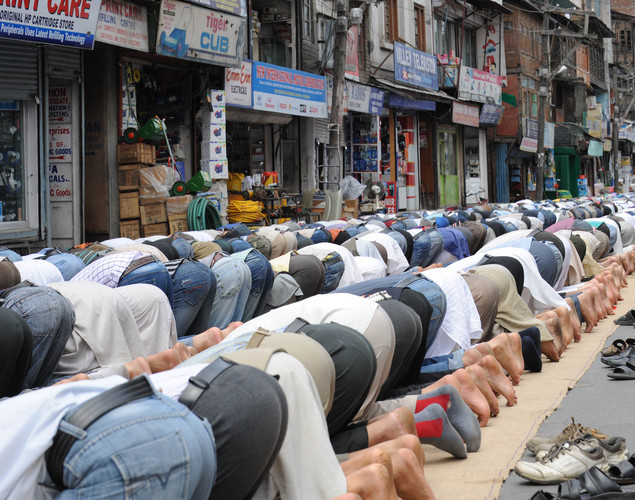 Kashmiri Muslims perform congregational prayers on a street during the first day of the fasting month of Ramadan in Srinagar.