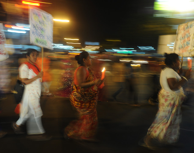 Indian sex workers hold candles and posters as they march in a May Day rally asking for their rights and the recognition of their profession on the eve of the International Labor Day, in Kolkata on late April 30, 2012.