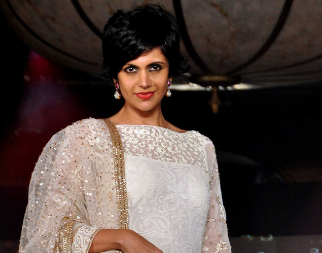 Mandira Bedi displays a creation by designer Manish Malhotra for a public awareness campaign 'Save and Empower the Girl Child' in Mumbai.