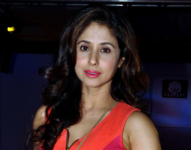 Urmila Matondkar poses as she attends a Cotton Council International Celebrates Cottonscape fashion show in Mumbai.