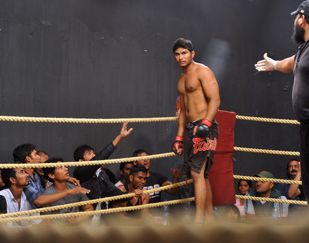 Mixed Martial Arts (MMA) fighter Alfan Hashmi (L) looks on as the referee stops the fight after a round at the FCC (Full Contact Championship) 6 fight night in Mumbai.