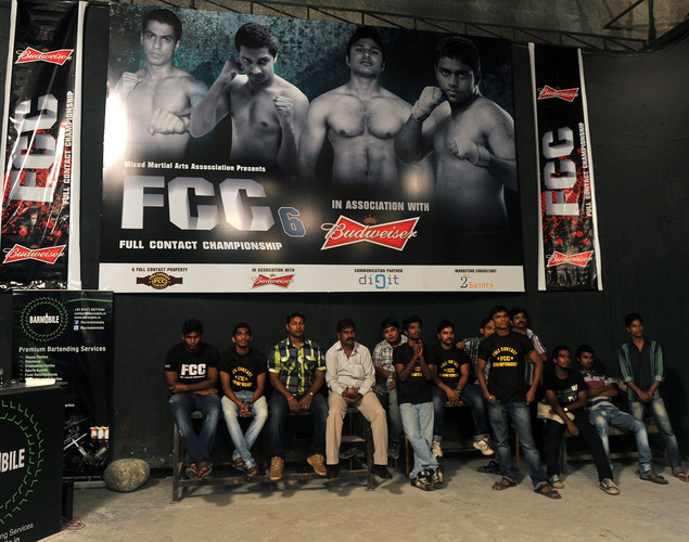 Friends and wellwishers of the fighters wait for the start of the Mixed Martial Arts (MMA) bout during the FCC (Full Contact Championship) 6 fight night in Mumbai.