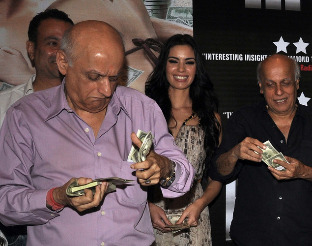 Film director Mukesh Bhatt,(L), film actress Mia Uyeda (C) and film director Mahesh Bhatt attend the success party for the cast of Hindi film 'Blood Money' in Mumbai.