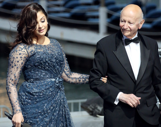 Indian actress Aishwarya Rai and the president of the Cannes Film Festival Gilles Jacob arrive for the TV show 'Le Grand Journal' on the set of French TV Canal+ during the 65th Cannes film festival.