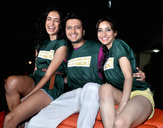 "Ritesh Deshmukh (C) poses with Neha Sharma (R) and Sarah Jane Dias (L) during a promotional event for the forthcoming Hindi film ""Kyaa Super Kool Hai Hum"" directed by Sachin Yardi in Mumbai."