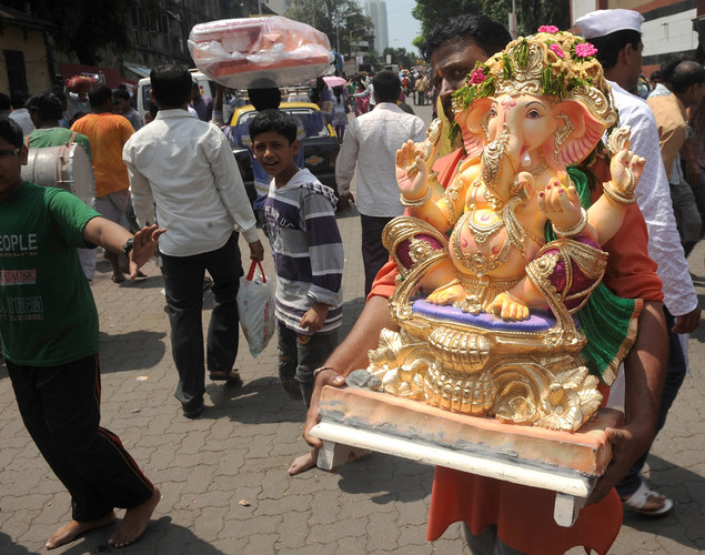 Indian Hindu devotees take home an idol of the elephant-headed Hindu god Lord Ganesha on 'Ganesh Chaturthi', in Mumbai.